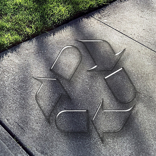 recycling logo printed on concrete