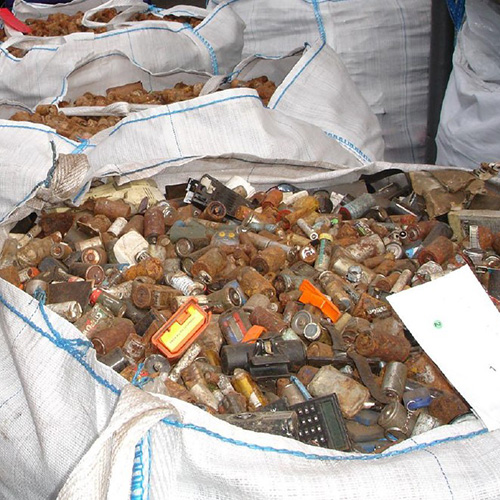 image of old rusty batteries going through a recycle process